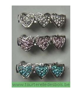 Barette avec 3 coeurs en strass bleu